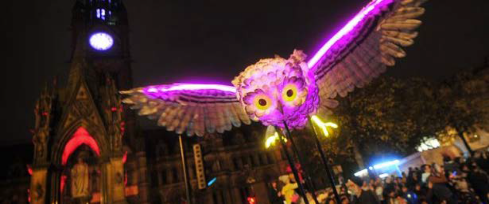 A huge purple and gold illuminated owl; part of the Manchester Diwali celebrations.