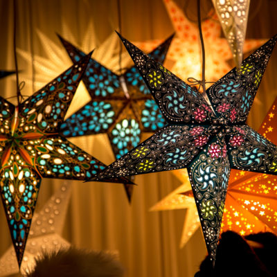 Paper star shaped lamps lit up