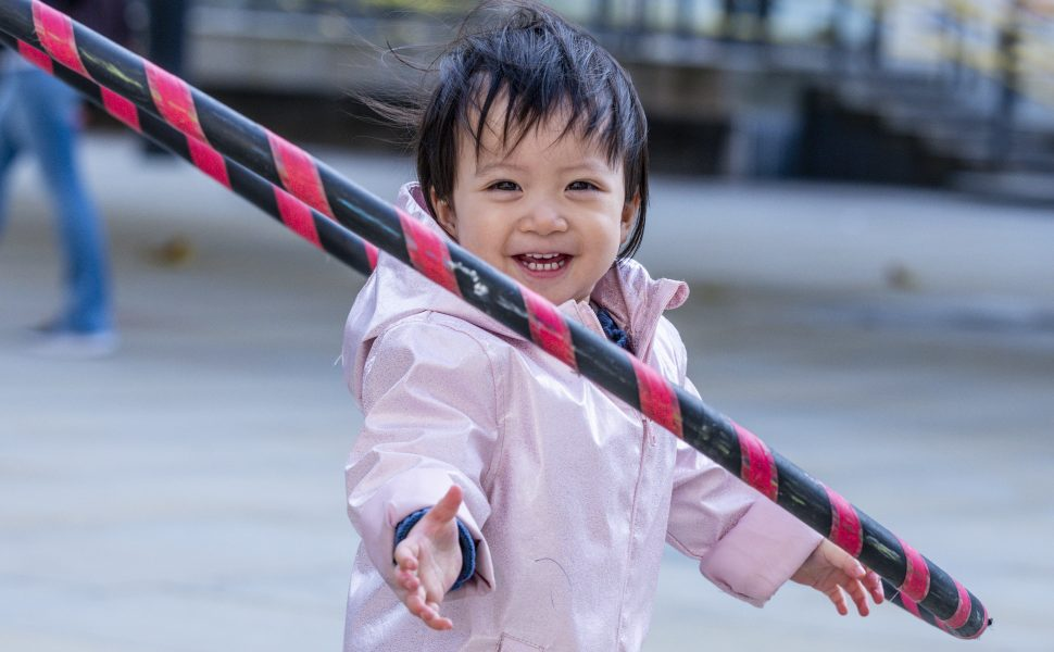 A child plays with a hula hoop