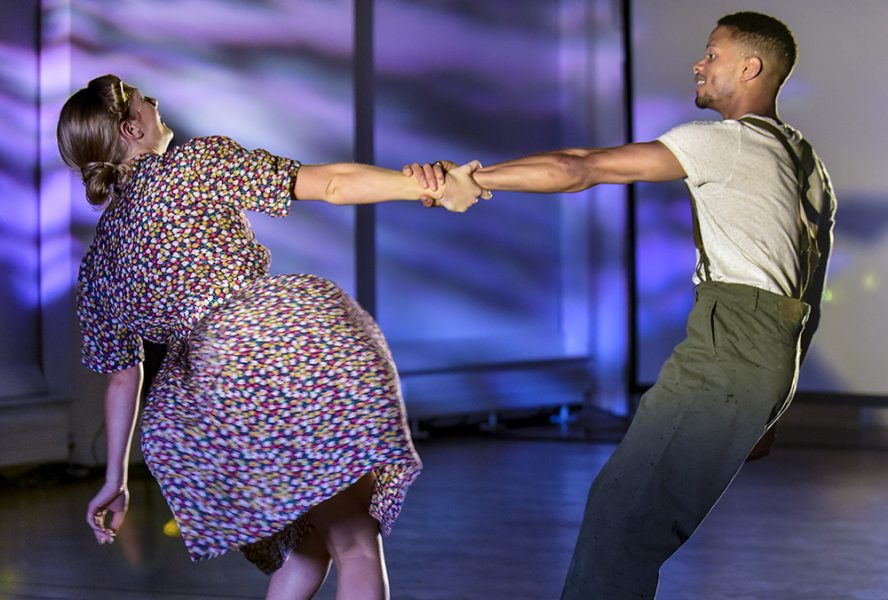 A woman and a man dance together