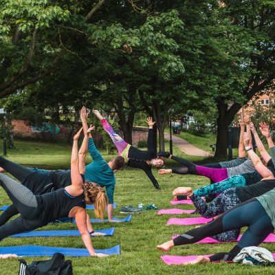 A group of people enjoying a yoga class in the open air.