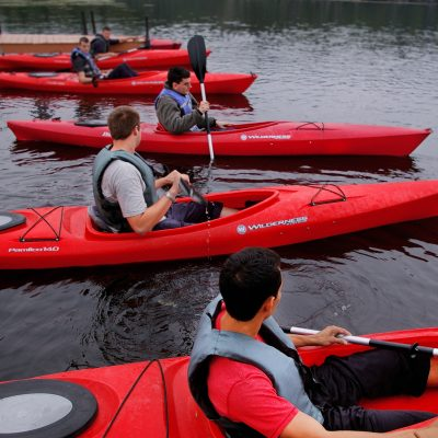 A group of people in canoes at Debdale Outdoor Centre