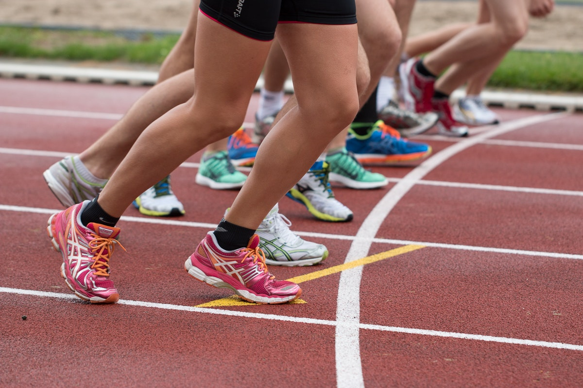 A close-up picture of several runners legs at Manchester Regional Arena