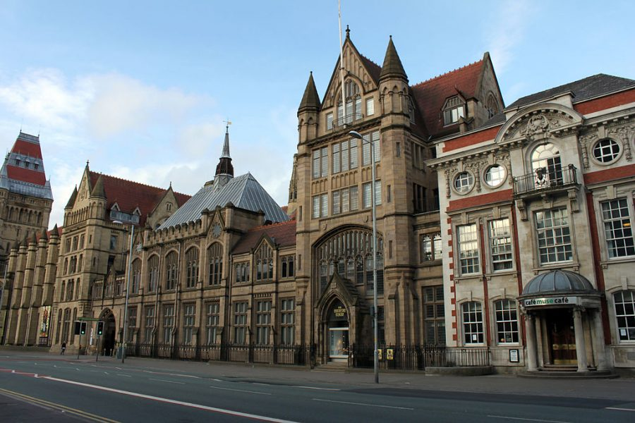 Manchester museum is a long building with lots of windows and doors