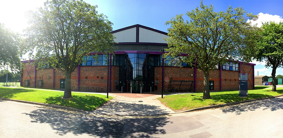 Outside of sports centre on a sunny day