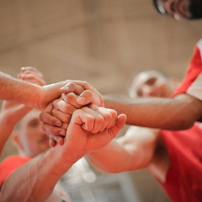 Group of sports players bumping fists.