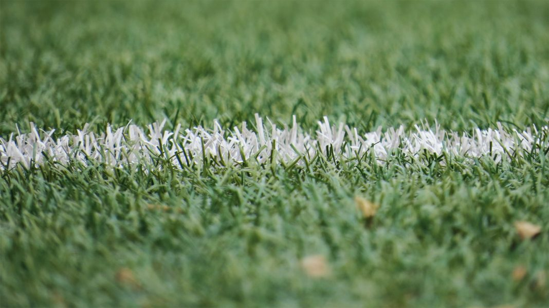 A closeup of white line on a football pitch