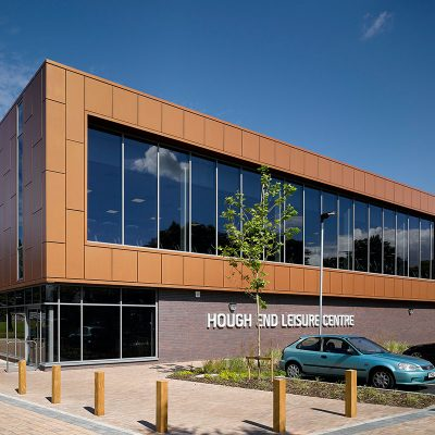 Outside of Hough End Leisure Centre on a sunny day