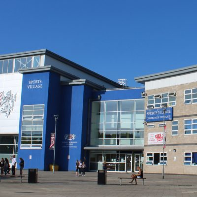 A group of people outside a sports centre