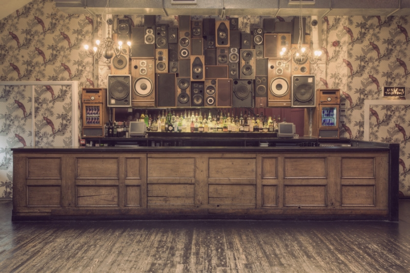 A stack of speakers behind a bar