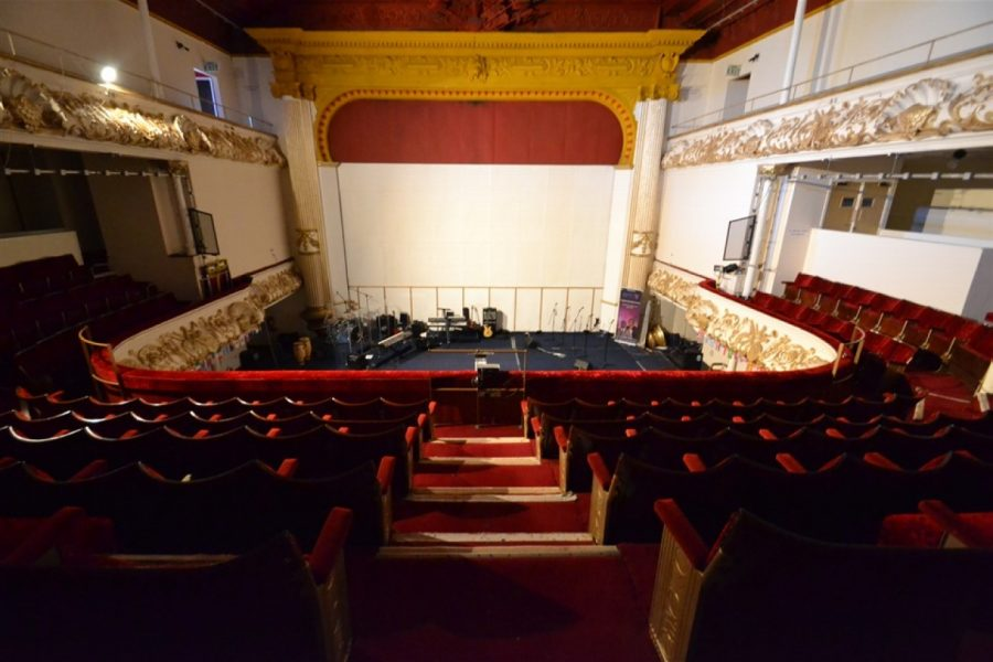 Empty theatre, with gear on stage