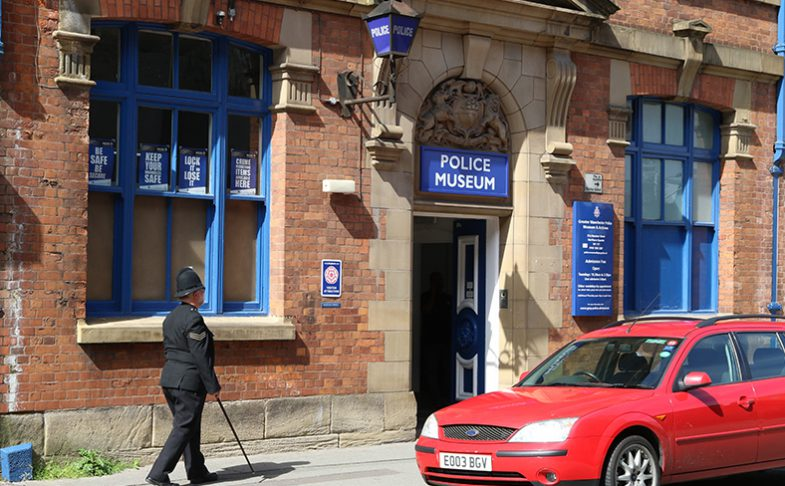 A man stands outside The Police Museum