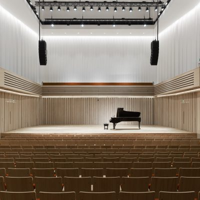 An empty theatre with a piano on stage