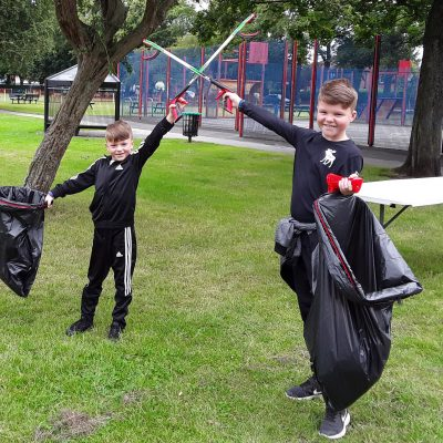 Two children with litter pickers