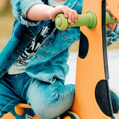 Closeup of a child, playing at a playground