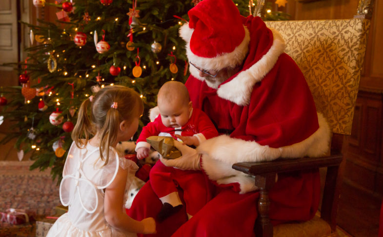 Two children with Santa Claus