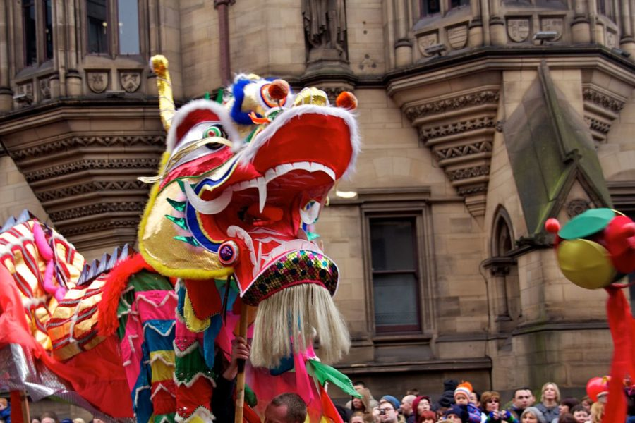 Chinese dragon puppet walks in front of crowd