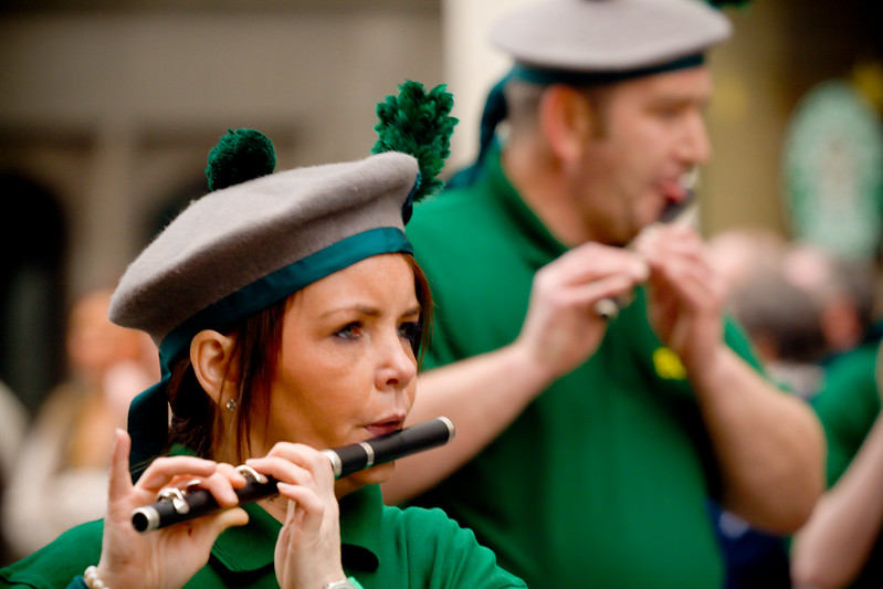 A lady plays an Irish flute in the Manchester Irish Parade.
