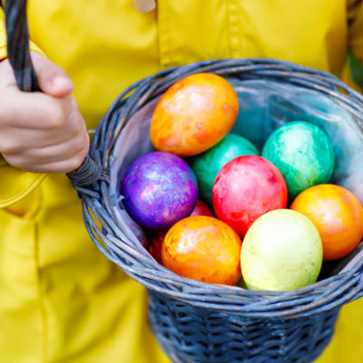 A collection of painted eggs in a basket.
