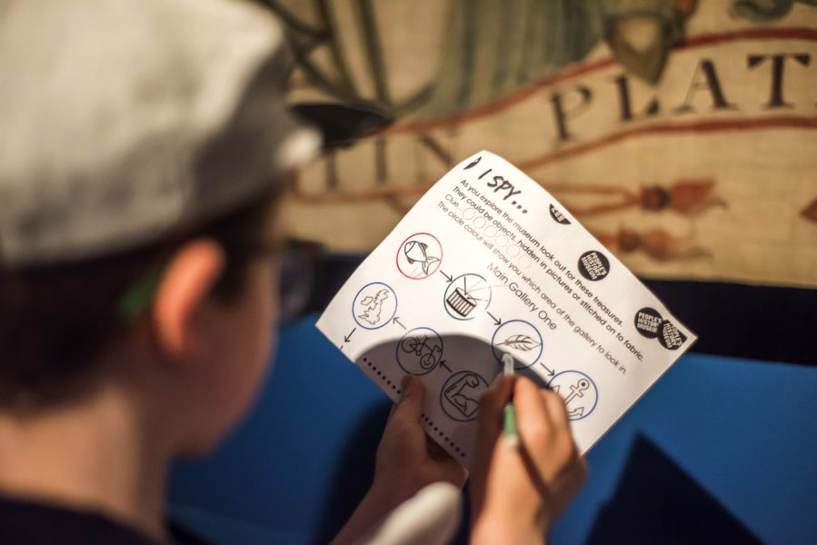 A child holds a ticket to the People's History Museum.