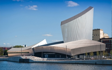 The outside of the Imperial War Museum North on a sunny day.