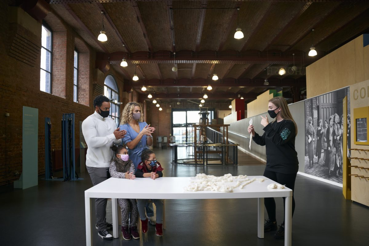 A family talk to a Museum Explainer to find out more about the exhibition.
