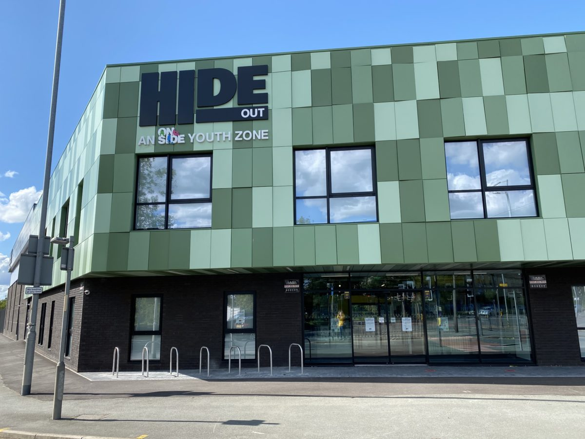 The outside of the HideOut Youth Zone building on a sunny day.