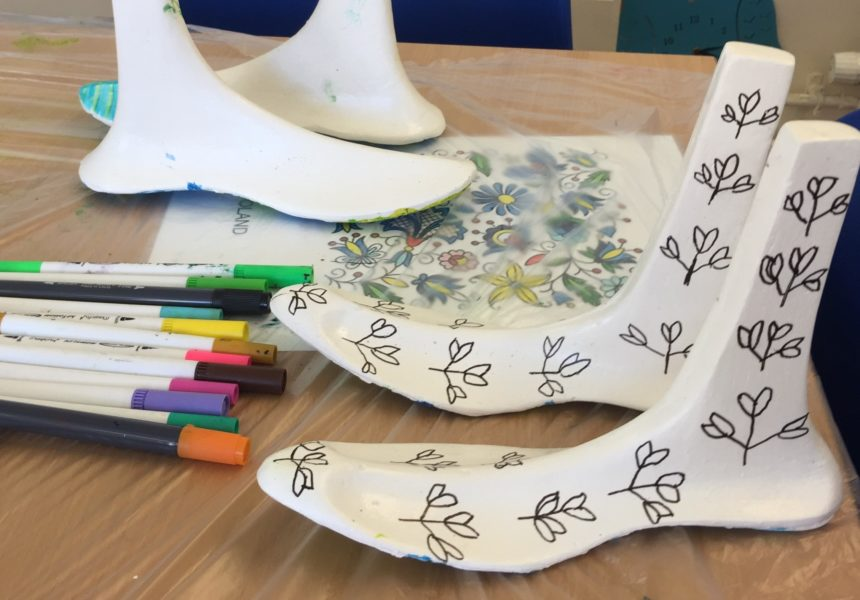 A decorated pair of plaster cast feet created at the Identity Feet workshop.