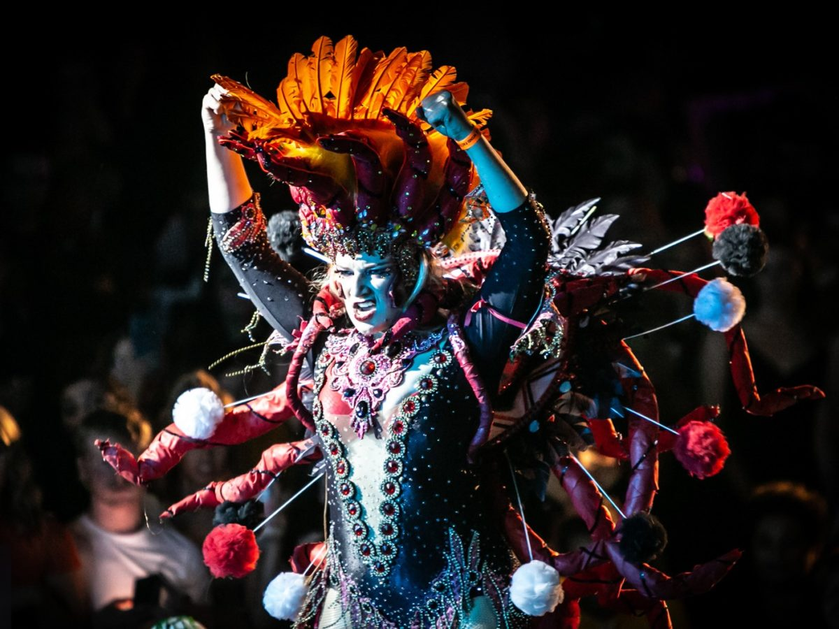 A vogue dancer in an extravagant costume struts their stuff at the Vogue Ball Manchester.