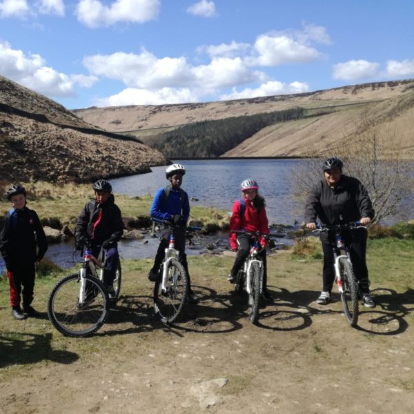 A group of young mountain bikers getting ready to set off.