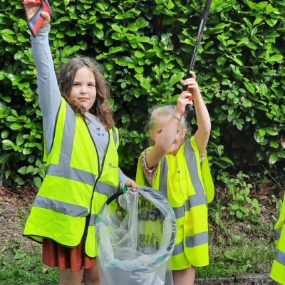 Children take part in a litter pick at Broadhurst Community Centre in Moston.