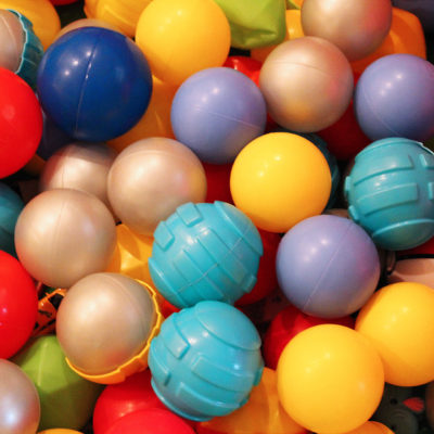 A pile of brightly coloured balls at a children's play centre.