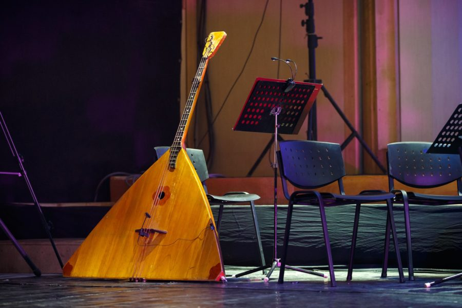 A balalaika (a Russian stringed musical instrument) sits on a stage.
