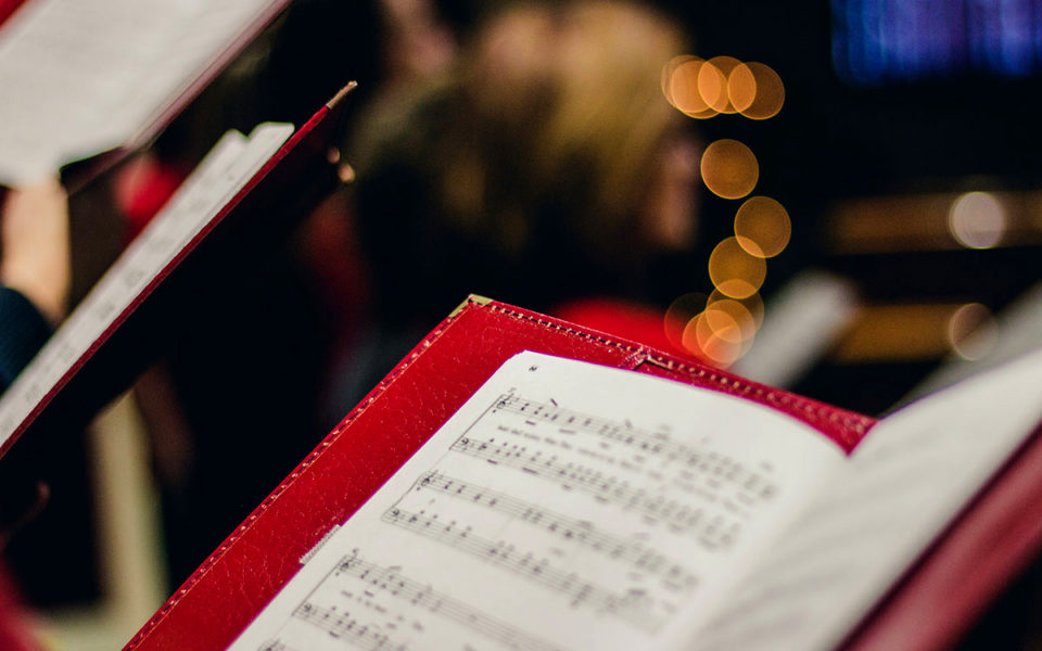 A red folder with sheet music.