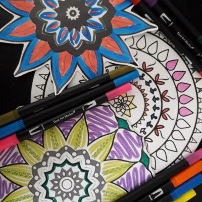 A brightly coloured Diwali colouring in sheet and some flet tip pens.