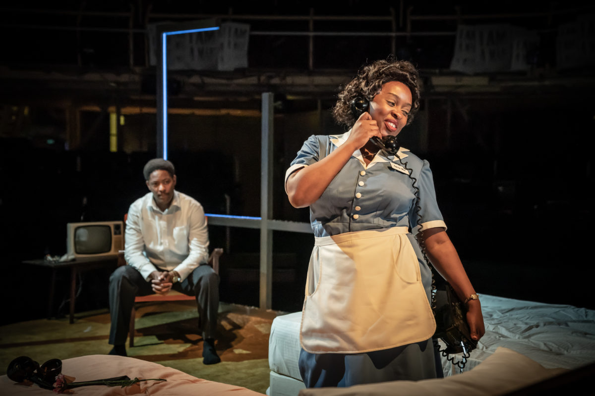 Two actors perform on stage in The Mountaintop at the Royal Exchange Theatre.