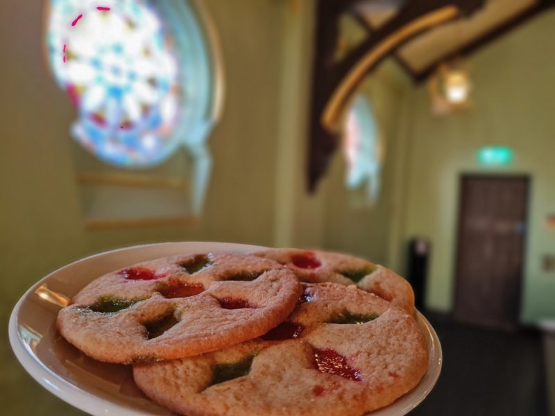 A plate of cookies that are inspired by the design and colour of a stained glass window.