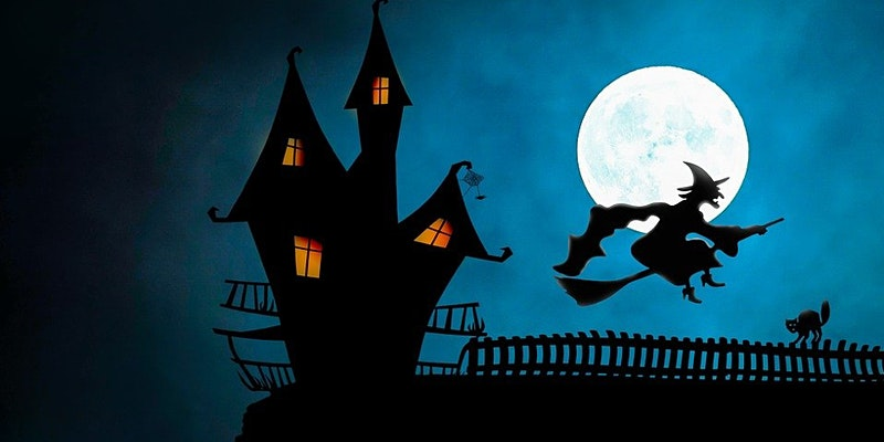 A spooky looking house on the night of a full moon as a witch flies past on a broomstick.