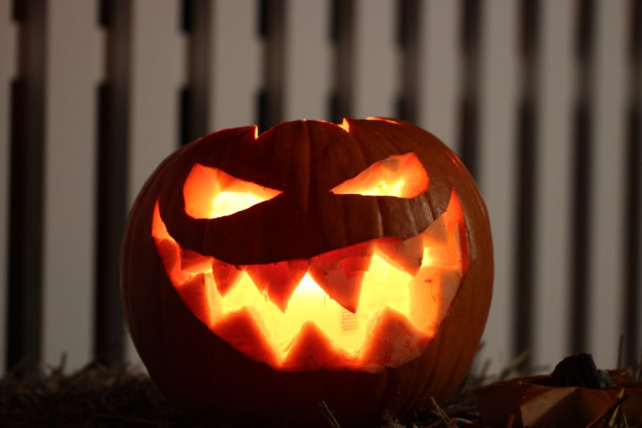 A glowing pumpkin with a face carved into it.